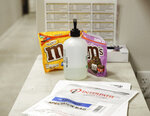 An unused test specimen bag sits at an employee station at Primary Health Medical Group's clinic in Boise, Idaho, Tuesday, Nov. 24, 2020. Troops direct people outside the urgent-care clinic revamped into a facility for coronavirus patients as infections and deaths surge in Idaho and nationwide. Some 1,000 people have died due to COVID-19, and infections this week surpassed 100,000. (AP Photo/Otto Kitsinger)