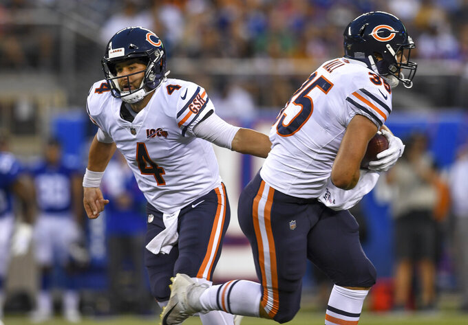 Chicago Bears quarterback Chase Daniel (4) hands off the ball to running back Ryan Nall (35) during the first quarter of a preseason NFL football game against the New York Giants, Friday, Aug. 16, 2019, in East Rutherford, N.J. (AP Photo/Sarah Stier)