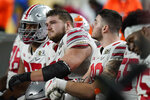Ohio State players sit on the bench after their loss to Alabama in an NCAA College Football Playoff national championship game, Monday, Jan. 11, 2021, in Miami Gardens, Fla. Alabama won 52-24. (AP Photo/Chris O'Meara)
