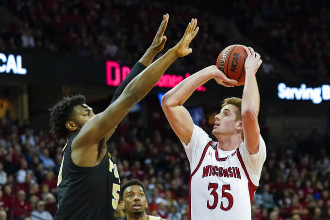 Wisconsin's Nate Reuvers (35) shoots against Purdue's Trevion Williams (50) during the second half of an NCAA college basketball game Tuesday, Feb. 18, 2020, in Madison, Wis. Wisconsin won 69-65.(AP Photo/Andy Manis)