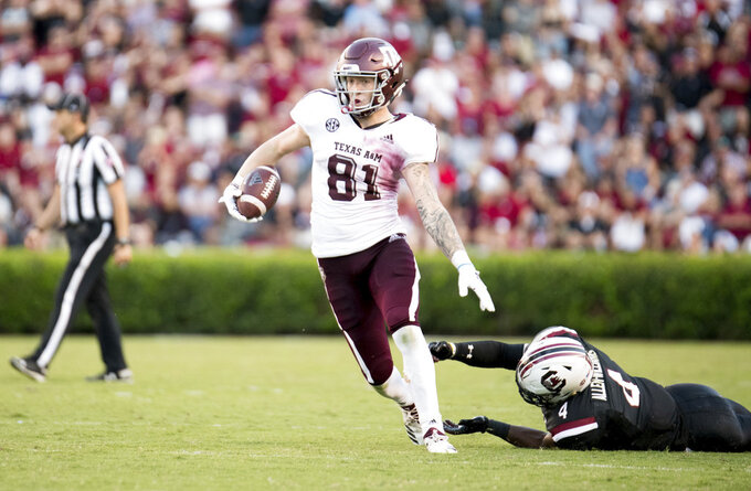 Texas A&M tight end Jace Sternberger (81) runs with the ball against South Carolina linebacker Bryson Allen-Williams (4) during the second half of an NCAA college football game Saturday, Oct. 13, 2018, in Columbia, S.C. Texas A&M defeated South Carolina 26-23. (AP Photo/Sean Rayford)