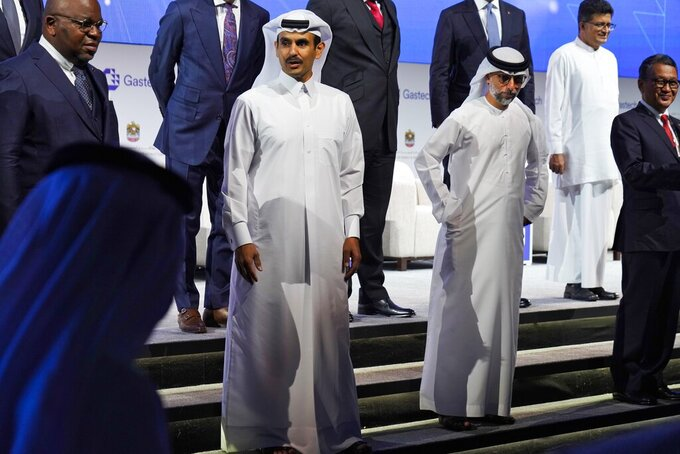 Qatar's Minister of State for Energy Affairs Saad Sherida al-Kaabi, center left, awaits a posed portrait with Emirati Energy and Infrastructure Minister Suhail al-Mazrouei, center right, during Gastech 2021 conference in Dubai, United Arab Emirates, Tuesday, Sept. 21, 2021. Energy officials from Qatar and Turkey, long-standing foes of the United Arab Emirates, descended on Dubai along with hundreds of other executives on Tuesday, flocking to the largest gas expo in the world and the industry's first in-person conference since the pandemic began. (AP Photo/Jon Gambrell)