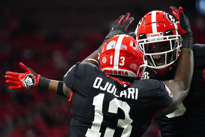 Georgia linebacker Azeez Ojulari (13) celebrates a sack on Cincinnati quarterback Desmond Ridder (9) during the second half of the Peach Bowl NCAA college football game, Friday, Jan. 1, 2021, in Atlanta. Georgia won 22-21. (AP Photo/Brynn Anderson)