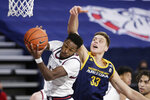 Gonzaga guard Joel Ayayi, left, grabs a rebound in front of Northern Arizona forward Carson Towt during the first half of an NCAA college basketball game in Spokane, Wash., Monday, Dec. 28, 2020. (AP Photo/Young Kwak)