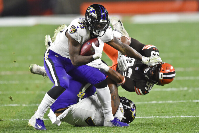 Baltimore Ravens running back Gus Edwards (35) pushes Cleveland Browns middle linebacker B.J. Goodson (93) during the second half of an NFL football game, Monday, Dec. 14, 2020, in Cleveland. (AP Photo/David Richard)