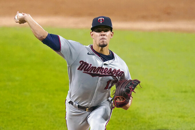 FILE - In this  Monday, Sept. 14, 2020 file photo, Minnesota Twins starting pitcher Jose Berrios delivers during the first inning of a baseball game against the Chicago White Sox in Chicago. Minnesota's pitching staff carried the load for the team last year, but it'll be a prove-it season again for most of the starters and relievers the Twins have assembled for 2021 in attempt to win a third straight AL Central title. Jose Berrios is at the top of the list. (AP Photo/Charles Rex Arbogast, File)