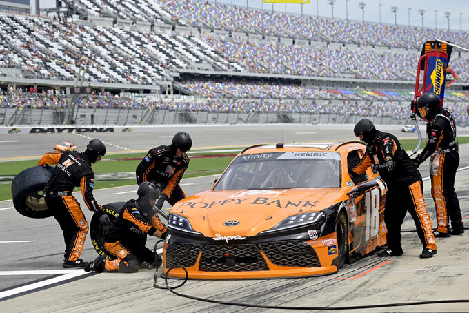Daniel Hemric (18) makes a pit stop during the NASCAR Xfinity Series auto race at Daytona International Speedway, Saturday, Aug. 28, 2021, in Daytona Beach, Fla. (AP Photo/Phelan Ebenhack)