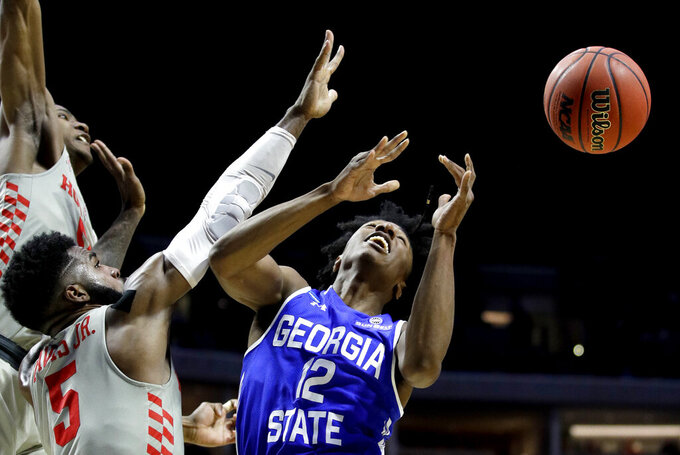Houston's Corey Davis Jr. (5) knocks the ball away from Georgia State's Kane Williams (12) during the second half of a first round men's college basketball game in the NCAA Tournament Friday, March 22, 2019, in Tulsa, Okla. (AP Photo/Charlie Riedel)