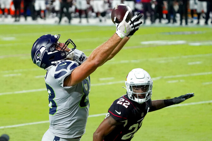 Seattle Seahawks tight end Greg Olsen (88) can't hold on in the end zone as Arizona Cardinals safety Deionte Thompson (22) defends during the first half of an NFL football game, Sunday, Oct. 25, 2020, in Glendale, Ariz. (AP Photo/Rick Scuteri)