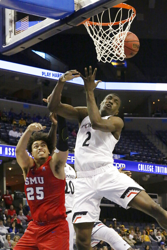SMU's Ethan Chargois and Cincinnati's Keith Williams try to grab a fast rebound in the second half of an NCAA college basketball game at the American Athletic Conference tournament Friday, March 15, 2019, in Memphis, Tenn. (AP Photo/Troy Glasgow)