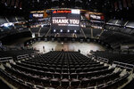 Voting machines are lined up on the floor of State Farm Arena, home of the NBA's Atlanta Hawks basketball team, Friday, July 17, 2020, in Atlanta. The 16,888-seat facility will be used as a poll location for the upcoming election. (AP Photo/John Bazemore)