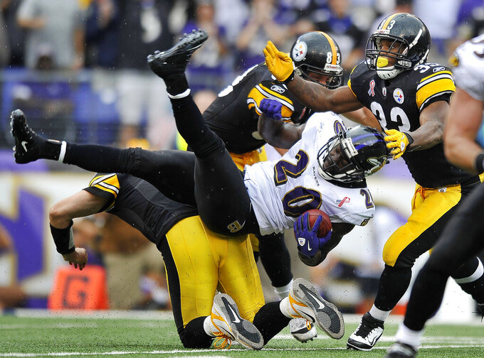 FILE - In this Sept. 11, 2011, file photo, Baltimore Ravens defensive back Ed Reed (20) is tackled after intercepting a pass from Pittsburgh Steelers quarterback Ben Roethlisberger in the second half of an NFL football game in Baltimore. Reed will be inducted into the Pro Football Hall of Fame in Canton, Ohio, on Aug. 3, 2019. (AP Photo/Gail Burton, File)