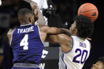 Kansas State forward Xavier Sneed (20) is fouled by Monmouth forward Mustapha Traore (4) during the first half of an NCAA college basketball game in Manhattan, Kan., Wednesday, Nov. 13, 2019. (AP Photo/Orlin Wagner)
