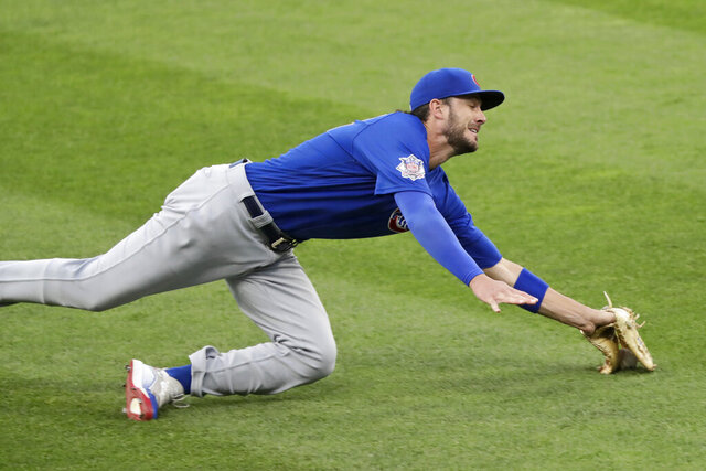 Chicago Cubs' Kris Bryant can't make the catch on a ball hit by Cleveland Indians' Cesar Hernandez in the fifth inning in a baseball game, Wednesday, Aug. 12, 2020, in Cleveland. Hernandez was safe at first base. (AP Photo/Tony Dejak)