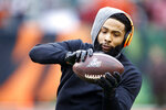 FILE - In this Dec. 29, 2019, file photo, Cleveland Browns wide receiver Odell Beckham Jr. catches a pass before an NFL football game against the Cincinnati Bengals in Cincinnati. Cleveland general manager Andrew Berry said Tuesday that Beckham has been fully committed to reporting to the team's facility. (AP Photo/Gary Landers, File)