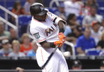 Miami Marlins' Cameron Maybin hits an RBI single during the fifth inning of the team's baseball game against the San Francisco Giants, Wednesday, June 13, 2018, in Miami. (AP Photo/Lynne Sladky)