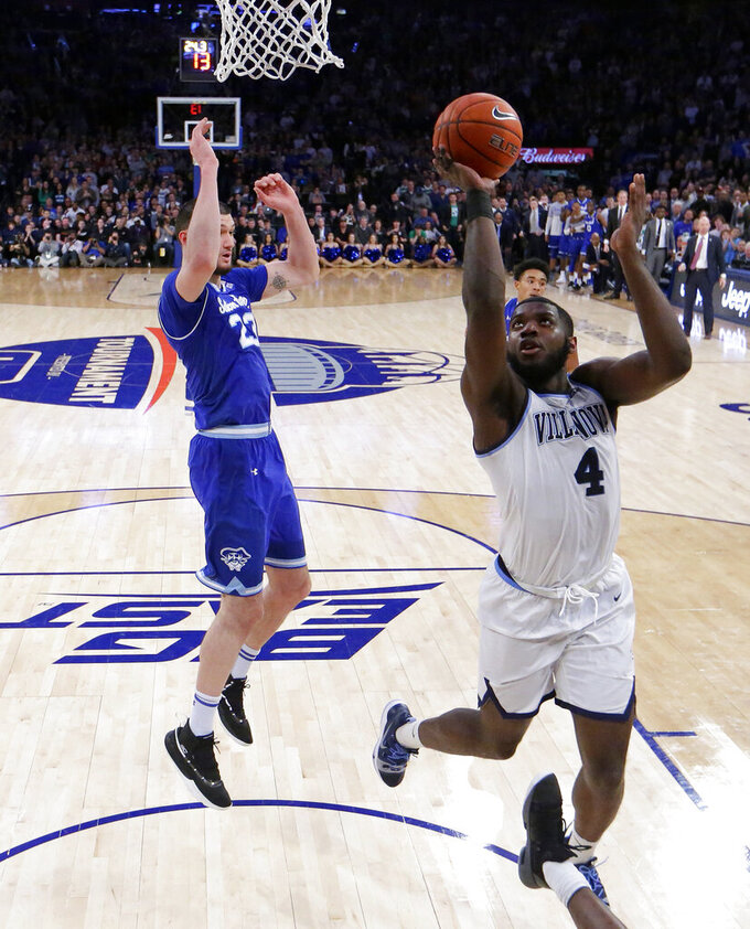 Villanova forward Eric Paschall (4) goes up for a shot against Seton Hall forward Sandro Mamukelashvili (23) during the first half of an NCAA college basketball game in the championship of the Big East Conference tournament, Saturday, March 16, 2019, in New York.  Villanova won 74-72. (AP Photo/Julio Cortez)