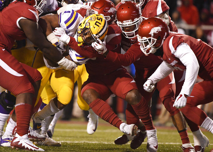 LSU running back Nick Brossette pushes through the Arkansas defense to score a touchdown during the first half of an NCAA college football game, Saturday, Nov. 10, 2018, in Fayetteville, Ark. (AP Photo/Michael Woods)