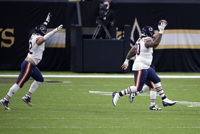 New Orleans Saints defensive tackle Malcom Brown (90) celebrates his fumble recovery in the first half of an NFL wild-card playoff football game against the New Orleans Saints in New Orleans, Sunday, Jan. 10, 2021. (AP Photo/Butch Dill)