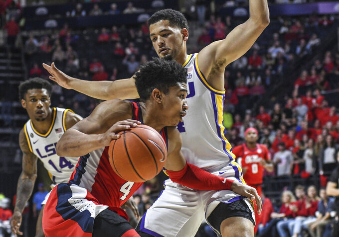 Mississippi guard Breein Tyree, front, drives against LSU guard Skylar Mays during an NCAA college basketball game in Oxford, Miss., Saturday, Jan. 18, 2020. (Bruce Newman/The Oxford Eagle via AP)