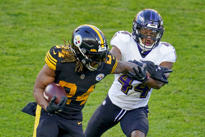 Pittsburgh Steelers running back Benny Snell (24) tries to break free from Baltimore Ravens cornerback Marlon Humphrey (44) on a run in the first half during an NFL football game, Wednesday, Dec. 2, 2020, in Pittsburgh. (AP Photo/Gene J. Puskar)