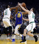 Boston Celtics' Kyrie Irving, left, and Gordon Hayward, right, defend against Golden State Warriors' Kevin Durant (35) during the first half of an NBA basketball game Tuesday, March 5, 2019, in Oakland, Calif. (AP Photo/Ben Margot)