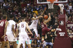 Boston College's Derryck Thornton, right is fouled while attempting a shot by Florida State's Devin Vassell in the second half of an NCAA college basketball game Saturday, March 7 2020, in Tallahassee, Fla. Florida State won 80-62. (AP Photo/Steve Cannon)