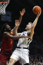 Butler's Derrik Smits (21) shoots over Louisiana Monroe's Chris Efretuei (0) during the first half of an NCAA college basketball game, Saturday, Dec. 28, 2019, in Indianapolis. (AP Photo/Darron Cummings)