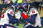 Houston Texans wide receiver DeAndre Hopkins (10) celebrates his touchdown with wide receiver Will Fuller (15) in the first half of an NFL football game against the New Orleans Saints in New Orleans, Monday, Sept. 9, 2019. (AP Photo/Butch Dill)
