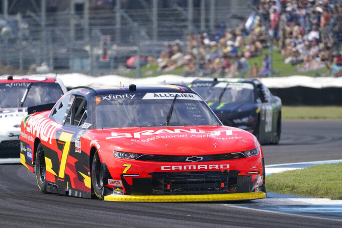 Justin Allgaier drives into a turn during a NASCAR Xfinity Series auto race at Indianapolis Motor Speedway, Saturday, Aug. 14, 2021, in Indianapolis. (AP Photo/Darron Cummings)