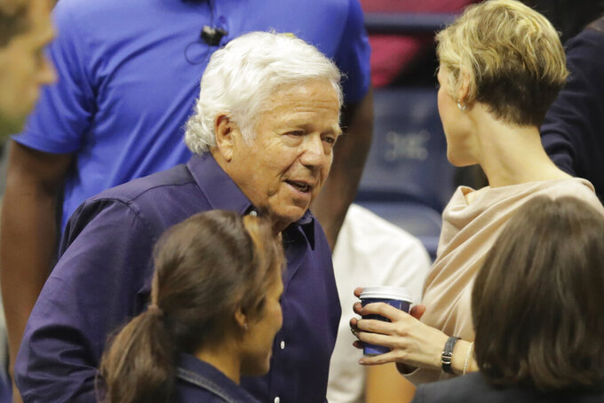 New England Patriots owner Robert Kraft gets up from his seat at courtside during the men's singles semifinals between Daniil Medvedev, of Russia, and Grigor Dimitrov, of Bulgaria, at the U.S. Open tennis championships Friday, Sept. 6, 2019, in New York. (AP Photo/Charles Krupa)