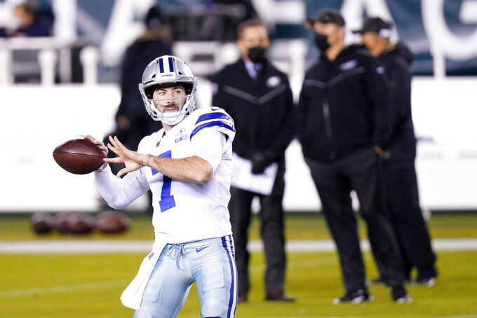 Dallas Cowboys' Ben DiNucci warms up before an NFL football game against the Philadelphia Eagles, Sunday, Nov. 1, 2020, in Philadelphia. (AP Photo/Chris Szagola)