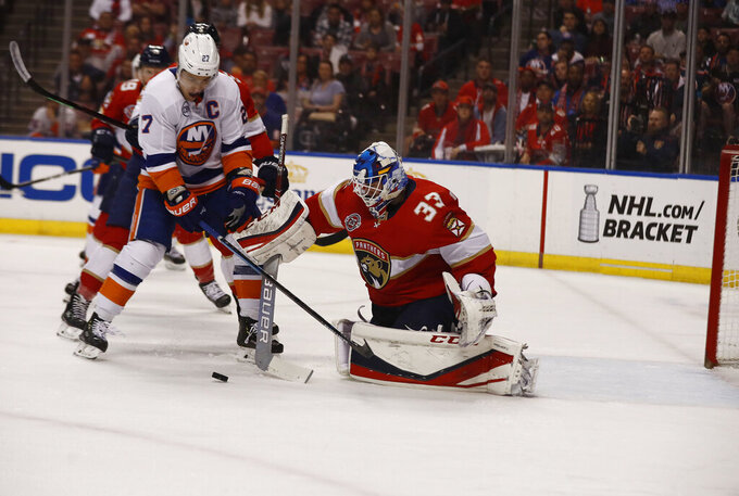 Florida Panthers goaltender Sam Montembeault (33) saves a goal against New York Islanders left wing Anthony Beauvillier (18) during the first period of an NHL hockey game on Thursday, April 4, 2019, in Sunrise, Fla. (AP Photo/Brynn Anderson)