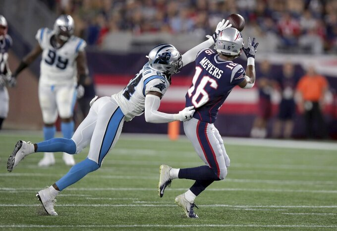 Carolina Panthers cornerback James Bradberry (24) breaks up a pass intended for New England Patriots wide receiver Jakobi Meyers (16) in the first half of an NFL preseason football game, Thursday, Aug. 22, 2019, in Foxborough, Mass. (AP Photo/Charles Krupa)