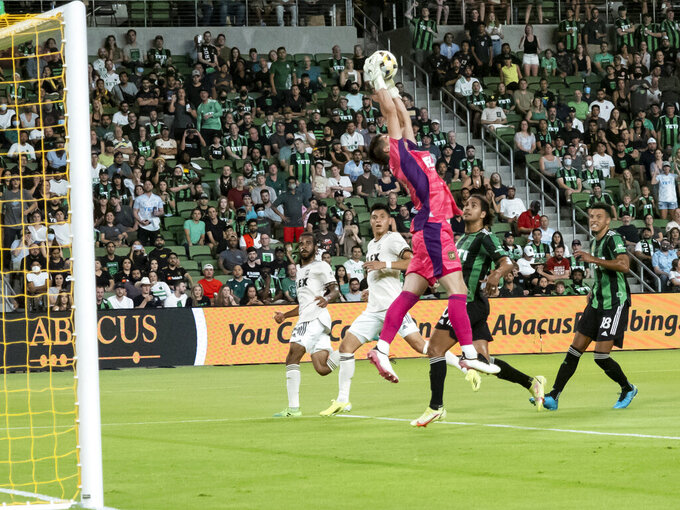 Los Angeles FC goalkeeper Tomas Romero goes up for a save during the first half of an MLS soccer match against Austin FC, Wednesday, Sept. 15, 2021, in Austin, Texas. (AP Photo/Michael Thomas)