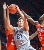 Penn State' forward John Harrar (21) and Illinois guard Andres Feliz (10) battle for the ball during the second half of an NCAA college basketball game in Champaign, Ill., Saturday, Feb. 23, 2019.(AP Photo/Robin Scholz)
