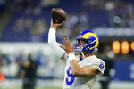 Los Angeles Rams quarterback Matthew Stafford (9) throws before an NFL football game between the Indianapolis Colts and the Los Angeles Rams, Sunday, Sept. 19, 2021, in Indianapolis. (AP Photo/Michael Conroy)