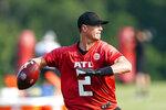 Atlanta Falcons quarterback Matt Ryan (2) throws a pass during their NFL training camp football practice Saturday, July 31, 2021, in Flowery Branch, Ga. (AP Photo/John Bazemore)