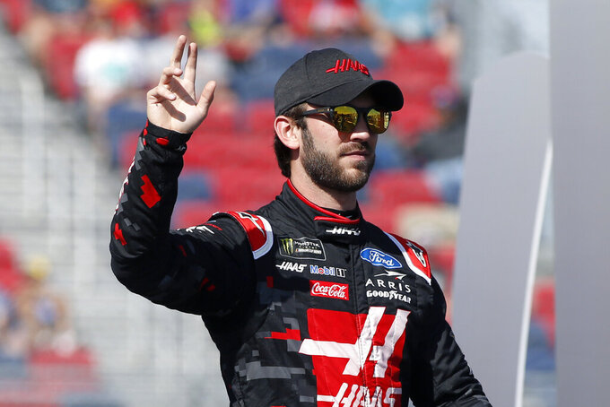 Daniel Suarez during driver introductions prior to the NASCAR Cup Series auto race at ISM Raceway, Sunday, Nov. 10, 2019, in Avondale, Ariz. (AP Photo/Ralph Freso)