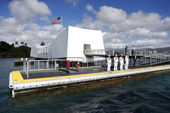 FILE - This Dec. 27, 2016 file photo shows the USS Arizona Memorial at Joint Base Pearl Harbor-Hickam, Hawaii, adjacent to Honolulu, Hawaii. The reopening of the memorial has been scheduled for Labor Day weekend following a 15-month closure. The Honolulu Star-Advertiser reported that walk-on access to the memorial in Honolulu will begin Sunday, Sept. 1, 2019. A malfunction with the concrete dock's anchoring system caused by exceptionally high tides in 2017 forced the closure of the memorial to foot traffic in May 2018. Officials say the repair project has cost more than $2.1 million. (AP Photo/Carolyn Kaster, File)
