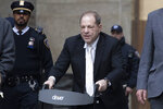 Harvey Weinstein leaves the courthouse following the second day of his rape trial, Thursday, Jan. 23, 2020, in New York. (AP Photo/Mark Lennihan)