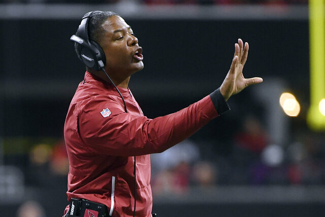 FILE - In this Dec. 16, 2018, file photo, Arizona Cardinals head coach Steve Wilks shouts during the first half of an NFL football game against the Atlanta Falcons in Atlanta. Wilks is returning to coaching as the defensive coordinator at Missouri. Wilks, who was hired by Tigers coach Eli Drinkwitz on Thursday, Jan, 21, 2021, took last year off after spending the previous 14 seasons in the NFL.  (AP Photo/John Amis, File)