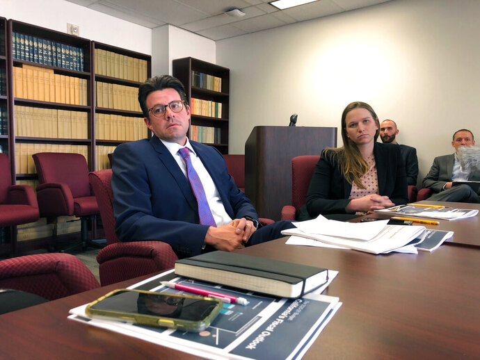 California Legislative Analyst Gabriel Petek, left, and Principal Fiscal and Policy Analyst Ann Hollingshead speak with reporters on Wednesday, Nov. 20, 2019, in Sacramento, Calif. The nonpartisan Legislative Analyst's Office on Wednesday predicted California will have a $7 billion surplus next year. (AP Photo/Adam Beam)
