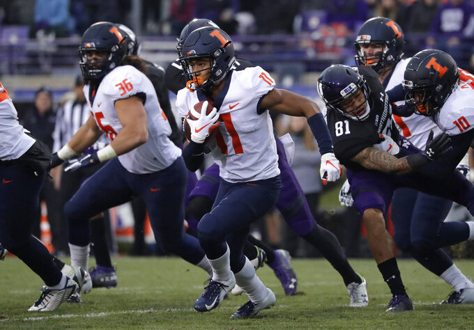 Illinois wide receiver Carlos Sandy (11) runs with the ball against Northwestern during the first half of an NCAA college football game in Evanston, Ill., Saturday, Nov. 24, 2018. (AP Photo/Nam Y. Huh)