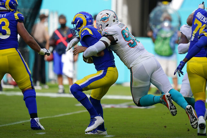 Miami Dolphins defensive end Shaq Lawson (90) sacks Los Angeles Rams quarterback Jared Goff (16), during the first half of an NFL football game, Sunday, Nov. 1, 2020, in Miami Gardens, Fla. (AP Photo/Wilfredo Lee)