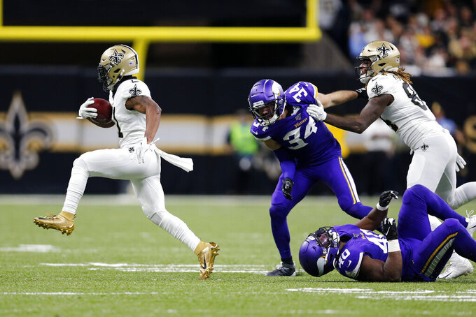 New Orleans Saints returner Deonte Harris carries on a kickoff return past Minnesota Vikings Andrew Sendejo (34) and Kentrell Brothers (40) in the first half of an NFL wild-card playoff football game, Sunday, Jan. 5, 2020, in New Orleans. (AP Photo/Brett Duke)