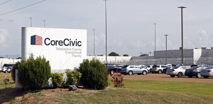 FILE - This Aug. 16, 2018, file photo shows the Tallahatchie County Correctional Facility operated by CoreCivic in Tutwiler, Miss. Private prison operator CoreCivic announced on Friday, April 16, 2021, that it has reached an agreement in principle to settle a shareholders' lawsuit for $56 million. The suit claimed the Tennessee-based company inflated stock prices by misrepresenting the quality and value of its services. Corecivic has said the allegations are untrue.  (AP Photo/Rogelio V. Solis, File)