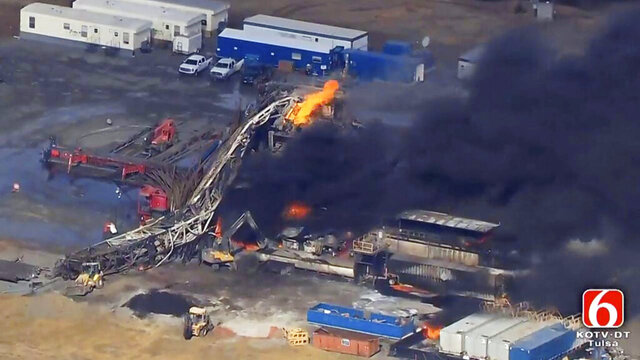 FILE - In this Jan. 22, 2018, file photo from video by Tulsa's KOTV/NewsOn6.com, fires burn at an eastern Oklahoma drilling rig near Quinton, Okla. A Pittsburg County, Okla., jury has found National Oilwell Varco, a Houston-based company partially responsible for the 2018 explosion and fire that killed five men. The jury ordered the company to pay $1 million each to the estates of Josh Ray of Fort Worth, Texas, and Cody Risk of Wellington, Colorado. (Christina Goodvoice/KOTV/NewsOn6.com via AP, File)