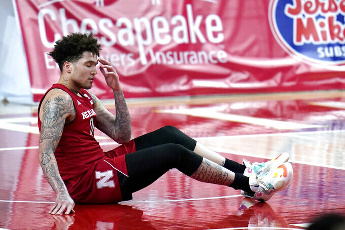 Nebraska guard Teddy Allen is slow to get iup after a turnover against Maryland during the second half of an NCAA college basketball game, Wednesday, Feb. 17, 2021, in College Park, Md. (AP Photo/Julio Cortez)