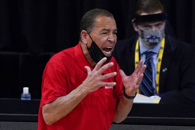 Houston head coach Kelvin Sampson reacts against Oregon State during the second half of an Elite 8 game in the NCAA men's college basketball tournament at Lucas Oil Stadium, Monday, March 29, 2021, in Indianapolis. (AP Photo/Michael Conroy)